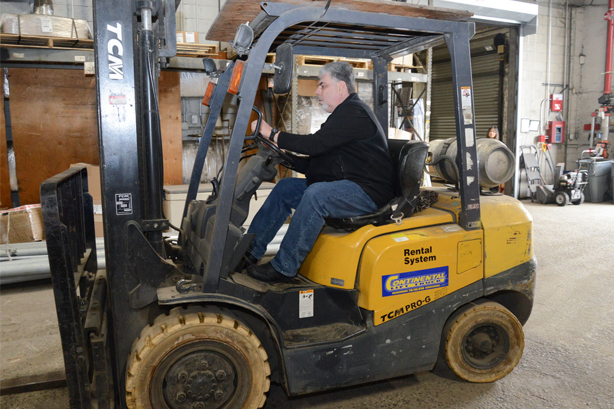 Employee driving a forklift