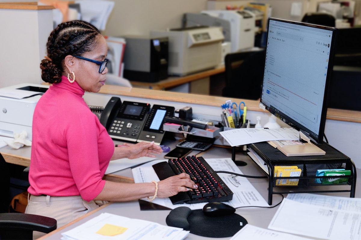 Female Horizon Air Freight working on computer
